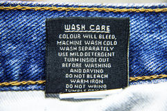 Specific instructions for washing Jeans. Wash care guidelines for jeans to wash them in machines. The specifications to follow for cleaning stock image