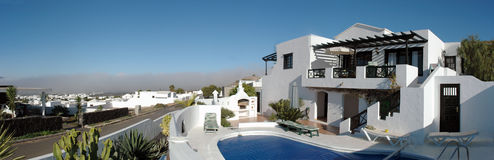 Specific Lanzarote houses. Lanzarote panorama with specific white houses and gardens. Oasis de Nazaret, Canary Islands Royalty Free Stock Photo