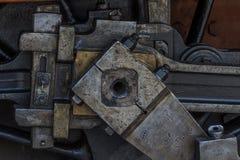 Specificerar av den greasy maskineri-/ångamotorn arkivbild