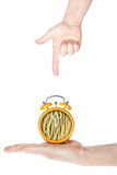 Specifying the correct time by hand. On a white background Royalty Free Stock Photography