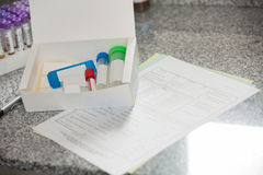 Specimen Bottles And Documents In Lab Royalty Free Stock Photos