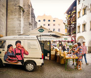 Speck alto adige. Bressanone, Italy, Aug 10 2017: people near a speck market stands in Trentino Alto Adige. Speck is a PGI traditional smoked ham of south tyrol stock photos