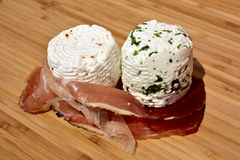 Speck,fresh cheese,chili. Speck with fresh cheese with chili and rocket Stock Photos