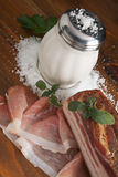 Speck ham. Italian Speck ham with salt and sage royalty free stock photos