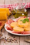 Speck ham and polenta. Speck ham and polenta on white dish stock photo