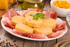 Speck ham and polenta. Speck ham and polenta on white dish stock photography