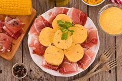 Speck ham and polenta. Speck ham and polenta on white dish stock photos