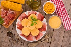 Speck ham and polenta. Speck ham and polenta on white dish royalty free stock image