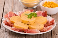 Speck ham and polenta. Speck ham and polenta on white dish royalty free stock images