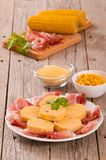 Speck ham and polenta. Speck ham and polenta on white dish royalty free stock photo