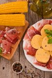 Speck ham and polenta. Speck ham and polenta on white dish royalty free stock photography