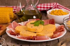 Speck ham and polenta. Speck ham and polenta on white dish royalty free stock photos