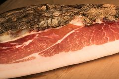 Italian speck. Speck on wooden background stock photo
