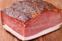 Speck. Italian speck on a wooden table stock photography