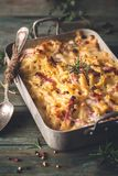 Speck and Rosemary Mac And Cheese Macaroni, Comfort Food for Winter. Speck and Rosemary Mac And Cheese Macaroni, Comfort Food for Winter on wooden background stock image