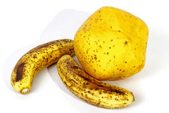 Speckled Bananas Alongside Ripe Yellow Paw Paw Stock Images