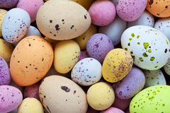 Speckled candy covered chocolate easter eggs. Still life photo of lots of  colourful speckled candy covered chocolate easter eggs Royalty Free Stock Photo