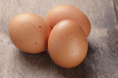 Speckled chicken eggs on old table Stock Photography