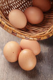 Speckled chicken eggs on old table Stock Images