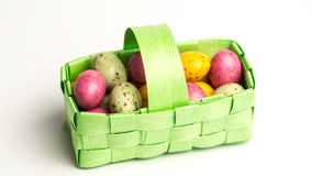 Speckled colourful easter eggs in a green basket Royalty Free Stock Photo