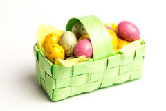 Speckled colourful easter eggs in a basket Stock Photos