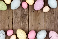 Speckled Easter egg double border against rustic wood Stock Image