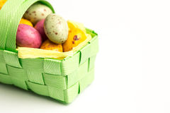 Speckled easter eggs in a basket Stock Photos