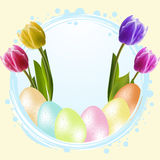 Speckled easter eggs and tulips Royalty Free Stock Images