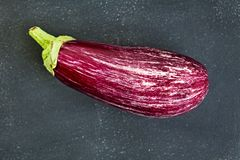 Speckled eggplant isolated on chalkboard Stock Photos