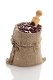 Speckled kidney beans in a burlap sack with scoop Stock Photo