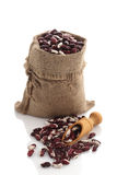 Speckled kidney beans in a burlap sack with scoop Stock Photos