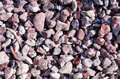Speckled peeble stones surface as natural background Royalty Free Stock Photo