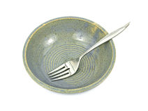 Speckled Pottery Bowl and Fork Royalty Free Stock Photography