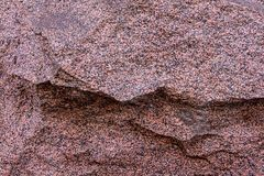 Speckled stone large terracotta split off part of the rock uneven surface granite texture rigid base royalty free stock photo