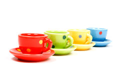 Speckles cups and saucers. Isolated over white royalty free stock images