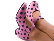Speckles shoes. A little lady with special speckles shoes on her feet Stock Images