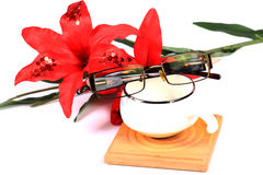 Specs and tea cup Royalty Free Stock Photos