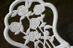 Spectacle of backrest of iron chair. Spectacle of backrest of flower pattern of iron chair Royalty Free Stock Images