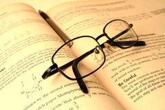 Spectacle and a book. A spectacle kept over a text book stock images