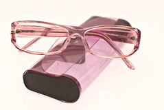 Spectacle case and glasses. Purple glasses and spectacle case on white background Stock Photos
