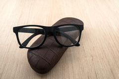Spectacle-case and glasses Stock Photography