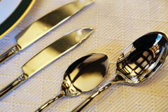 Spectacle of dishes on table. Spectacle of metal tableware on table Stock Photo