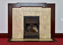Spectacle of room fireplace. And carpet Stock Image