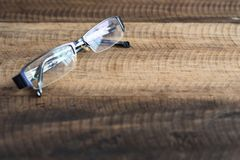 Spectacle on a wooden background. Spectacles with reflection of a window. image with copy space selective focus Royalty Free Stock Image