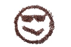 Spectacled Malicious smile smiley coffee beans isolated on a white background. Malicious smile smiley coffee beans isolated on a white background Stock Photo