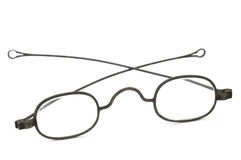 Spectacles. Antique wire frame spectacles with rounded earpieces Royalty Free Stock Images