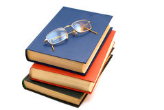 Free Spectacles And Stack Of Three Books Stock Photography - 11765762
