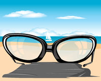 Spectacles on beach Stock Images