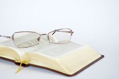 Spectacles and bible Royalty Free Stock Images