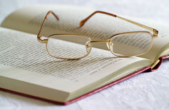 Spectacles and Book. On a table Stock Image